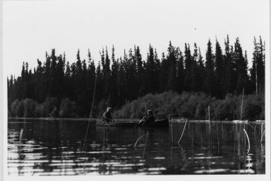 2 unidentified people in canoe
