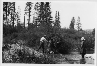 Unidentified people fishing in mountain stream