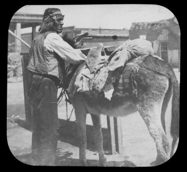 Native American man with donkey