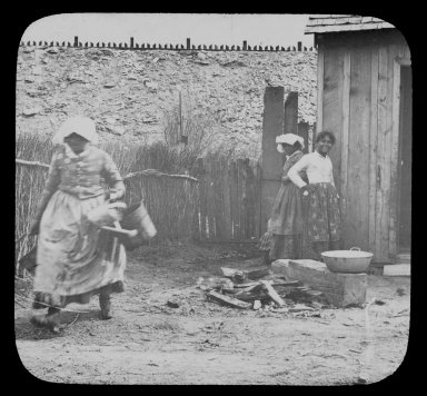 Woman and two girls in a yard