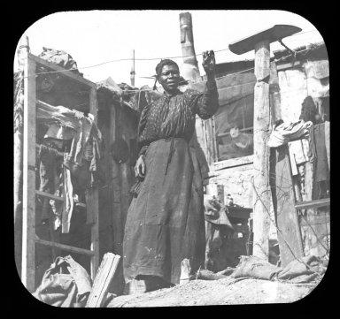 African American woman at the back of a house.