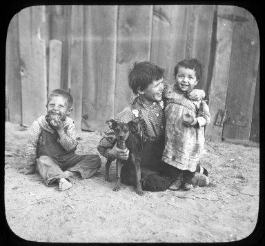 Three children and a dog