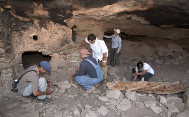 The field team examines the Hinkle Park Cliff Dwelling research site.