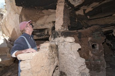 Dr.Steve Nash looks at the top of the structure at the Hinkle Park Cliff Dwelling.