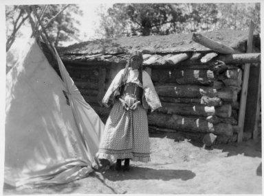 Mrs. Harry Gene in old-style modern dress.