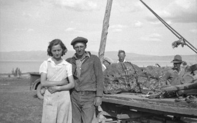 Unidentified man and woman with loaded specimen