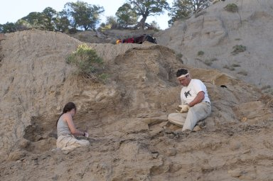 L-R: DMNS Volunteer Cynthia Russell and Dr. Kirk Johnson work at a dig site.