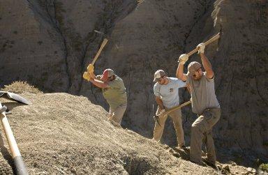 L-R: DMNS Volunteer Dane Miller, DMNS Volunteer David Allen and Dr. Ian Miller use picks to reveal the secrets of a dig site.