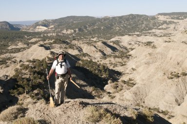 Dr. Kirk Johnson on a ridge top on the Kaiparowits Plateau.
