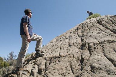 DMNS Volunteer Bryce Snellgrove(L) talks to Dr. Ian Miller up on the ridgeline.