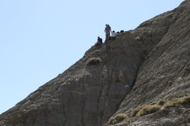 The DMNS Team perches precariously on the side of a ridge to excavate a site.