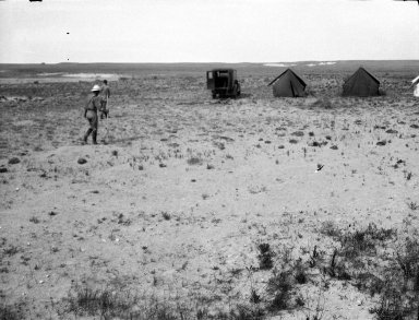 Field workers, tents & vehicle at unidentified excavation site