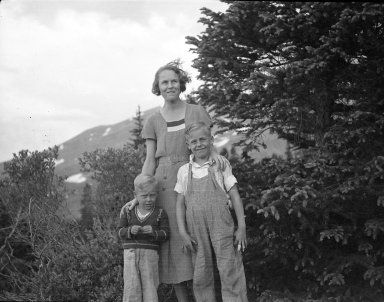 Unidentified woman and two boys