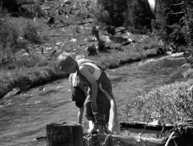 Two Boys Play in a Stream