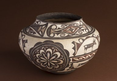 Zuni pottery jar with deer with heartline and rosette motif.
