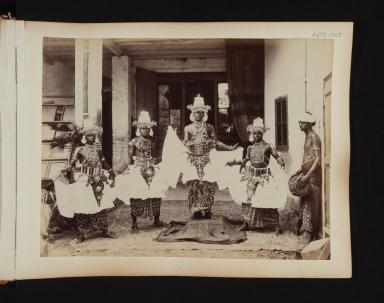 Five male dancers in costume from Sri Lanka.