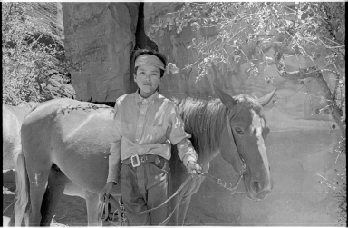 Adolescent Navajo male with a horse