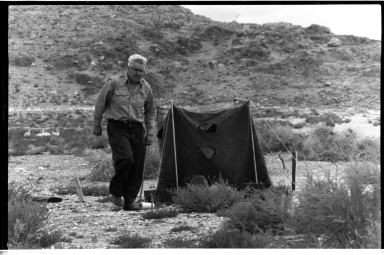 Alfred M. Bailey at a campsite