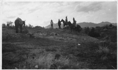 Portrait of Ute men with horses