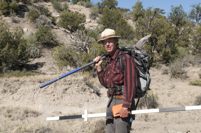 Dr. Bob Raynolds, DMNS Research Associate, heads out with his equipment for another day of prospecting.