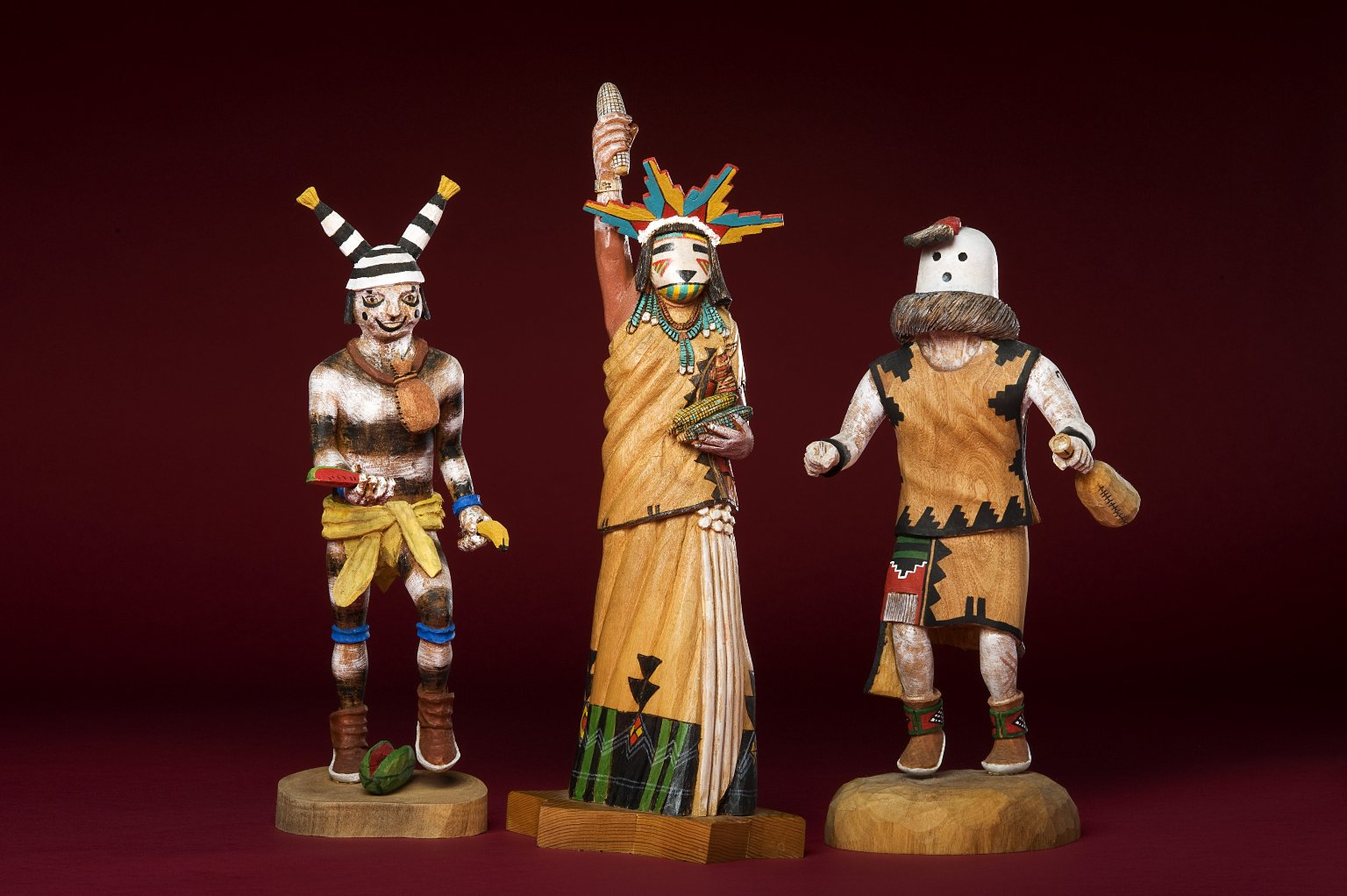 Three wood painted Kachina figures