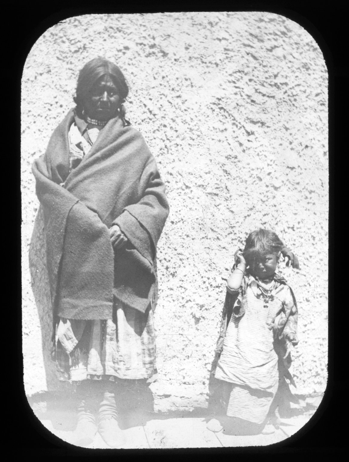 Apache woman and child.