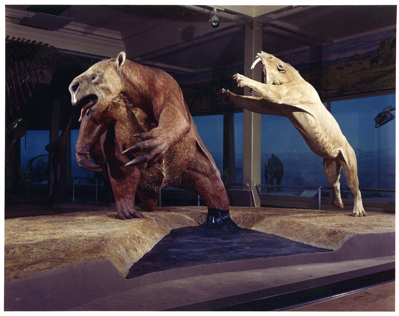 La Brea Tar Pit with giant sloth and sabertooth cat