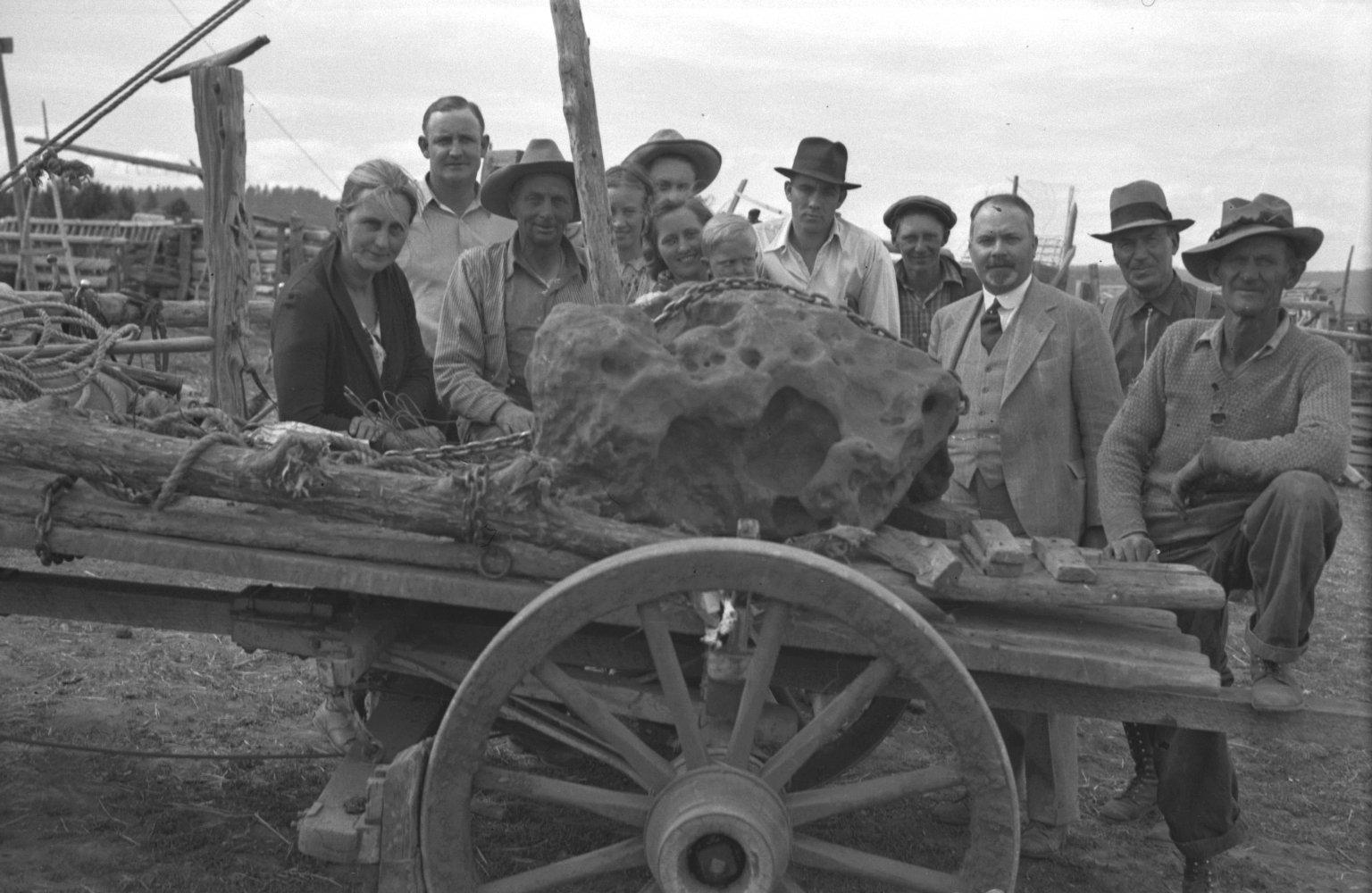 Crew gathered around loaded specimen