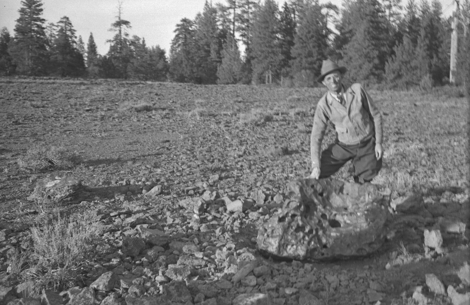 Harvey Nininger with meteorite in situ