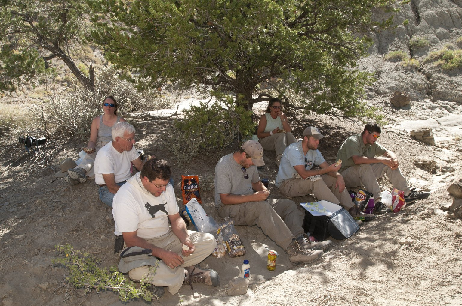 The Excavation Team takes a lunch break in the limited shade on the Kaiparowits Plateau.