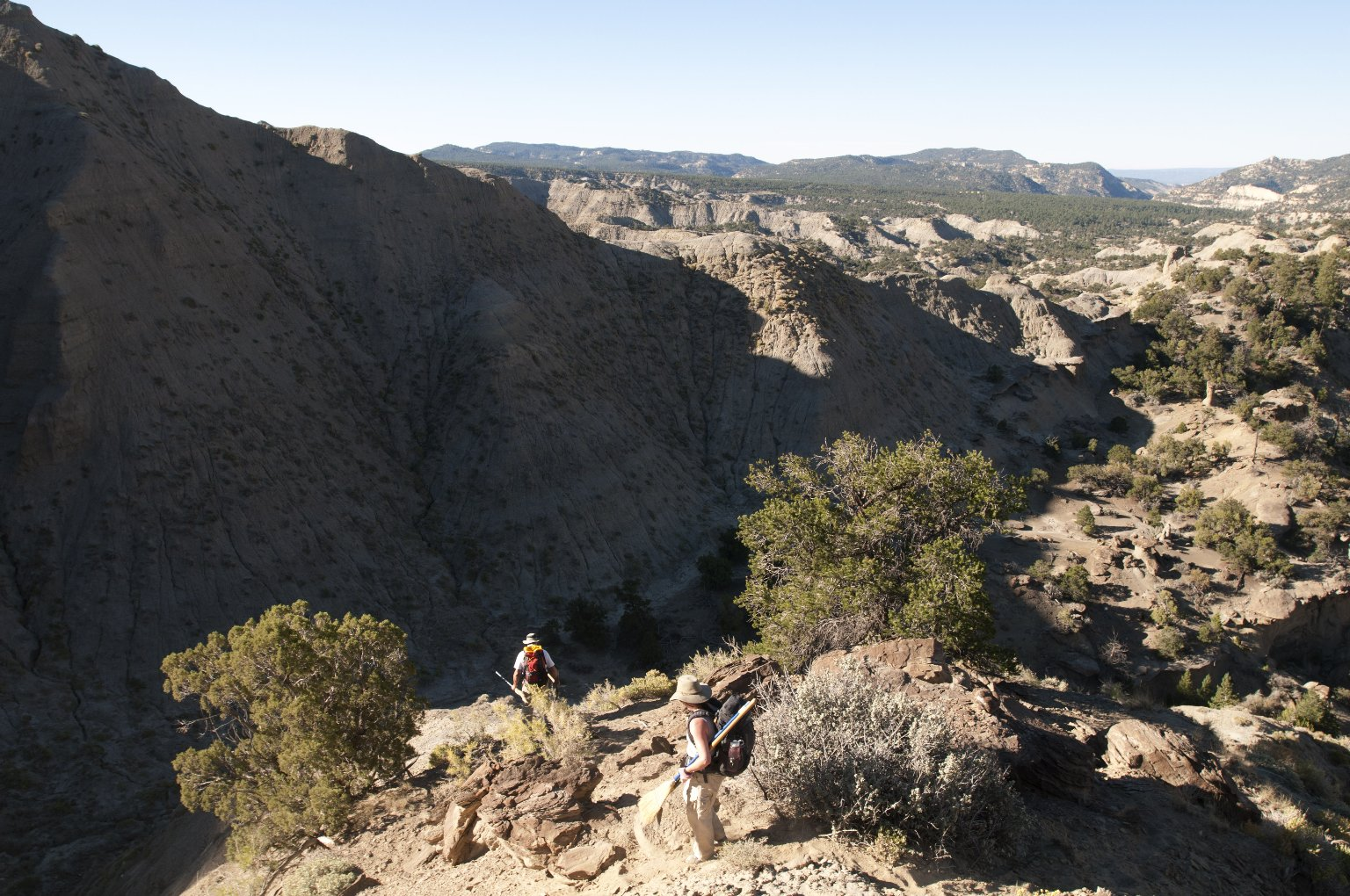 Dr. Kirk Johnson and DMNS volunteer Cynthia Russell descend into a canyon in the Kaiparowits Plateau.