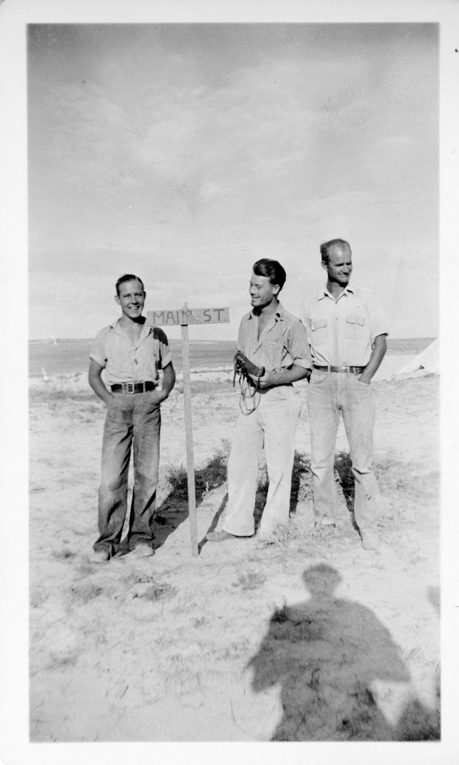 Three men in the field, Horsetail Creek Excavation