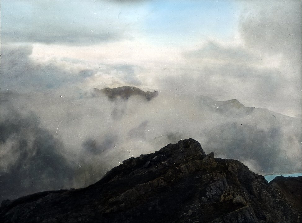 View of clouds and mountaintop
