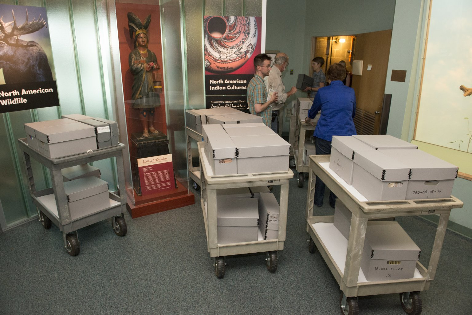 Conservationist Jude Southward and Department Head Brent Wagner moving archives to ECF building