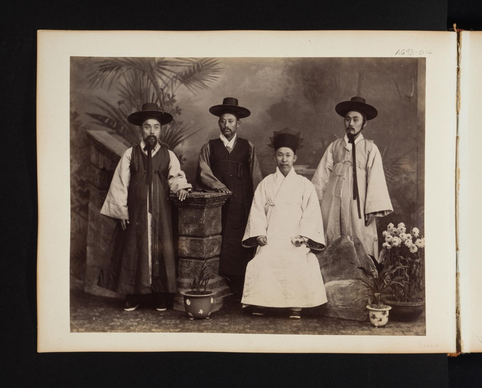 Group of four Korean men in costume.