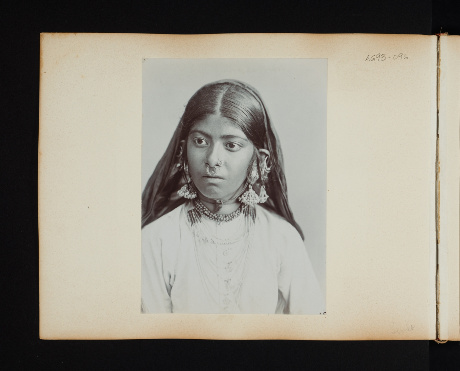 Portrait of a young woman with a nose ring and large earrings in Simla, India.