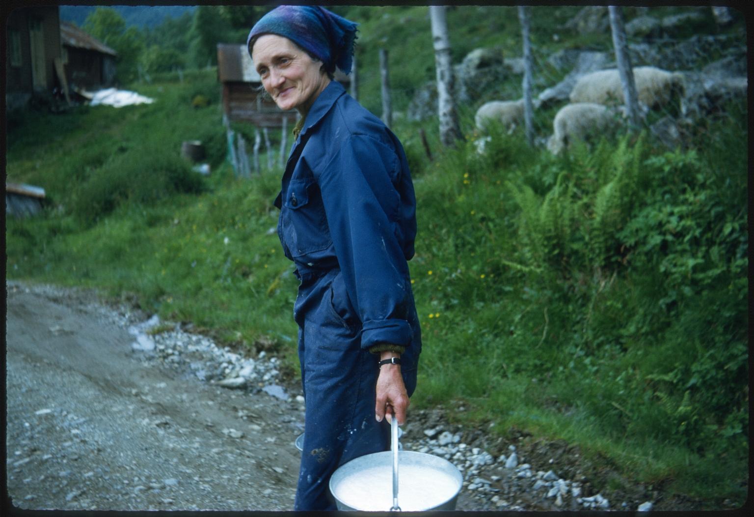 Woman carrying fresh milk in Norway