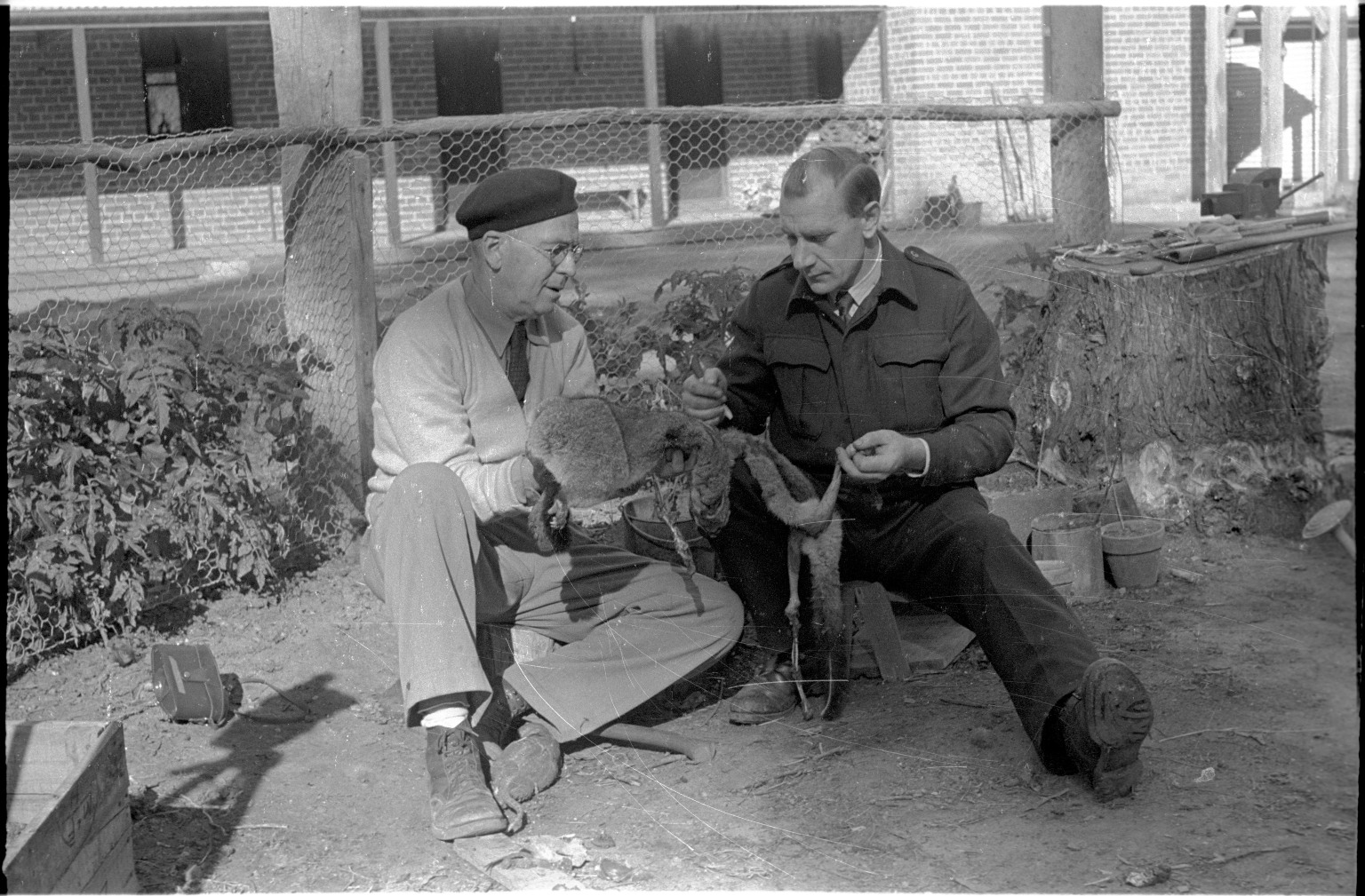 Alfred M. Bailey and Bob Boswell with a silver gray possum