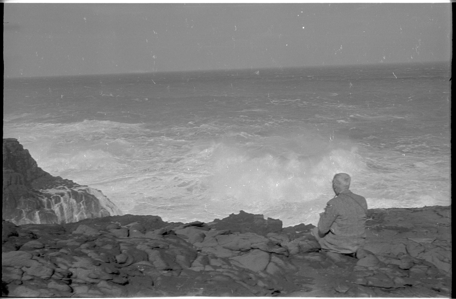 Alfred M. Bailey photographing on Cape Nelson
