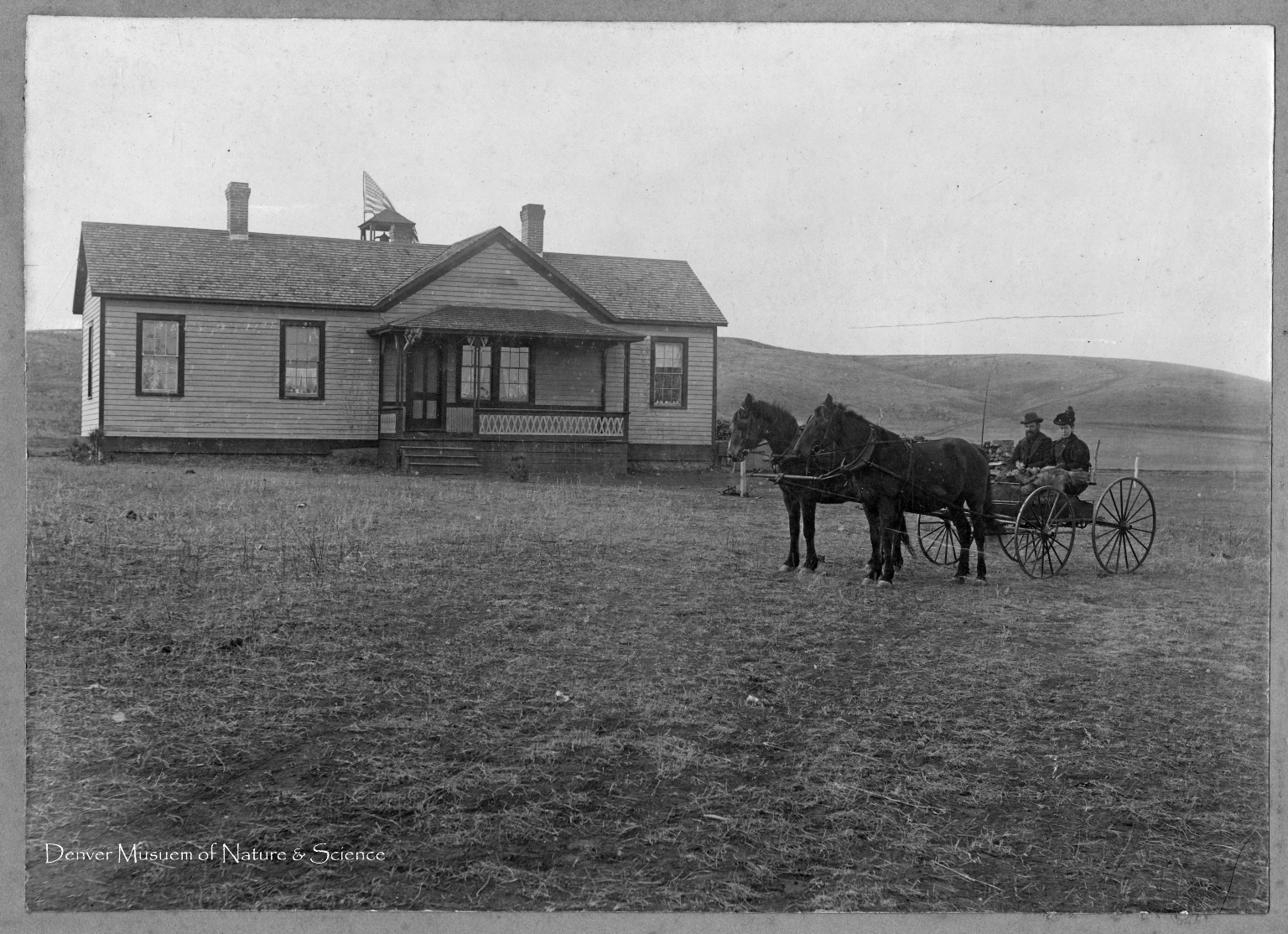 Mr. and Mrs. Whitwell in front of White River School