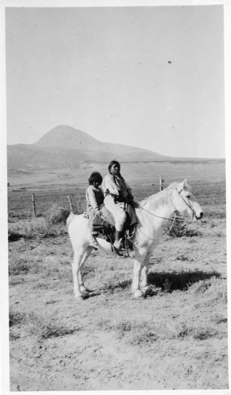 Portrait of Ute Mountain Ute woman and boy on a horse