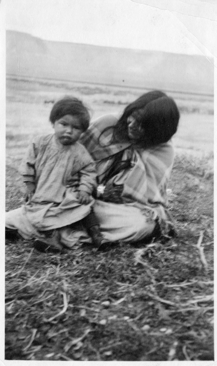 Portrait of a Ute woman with a child