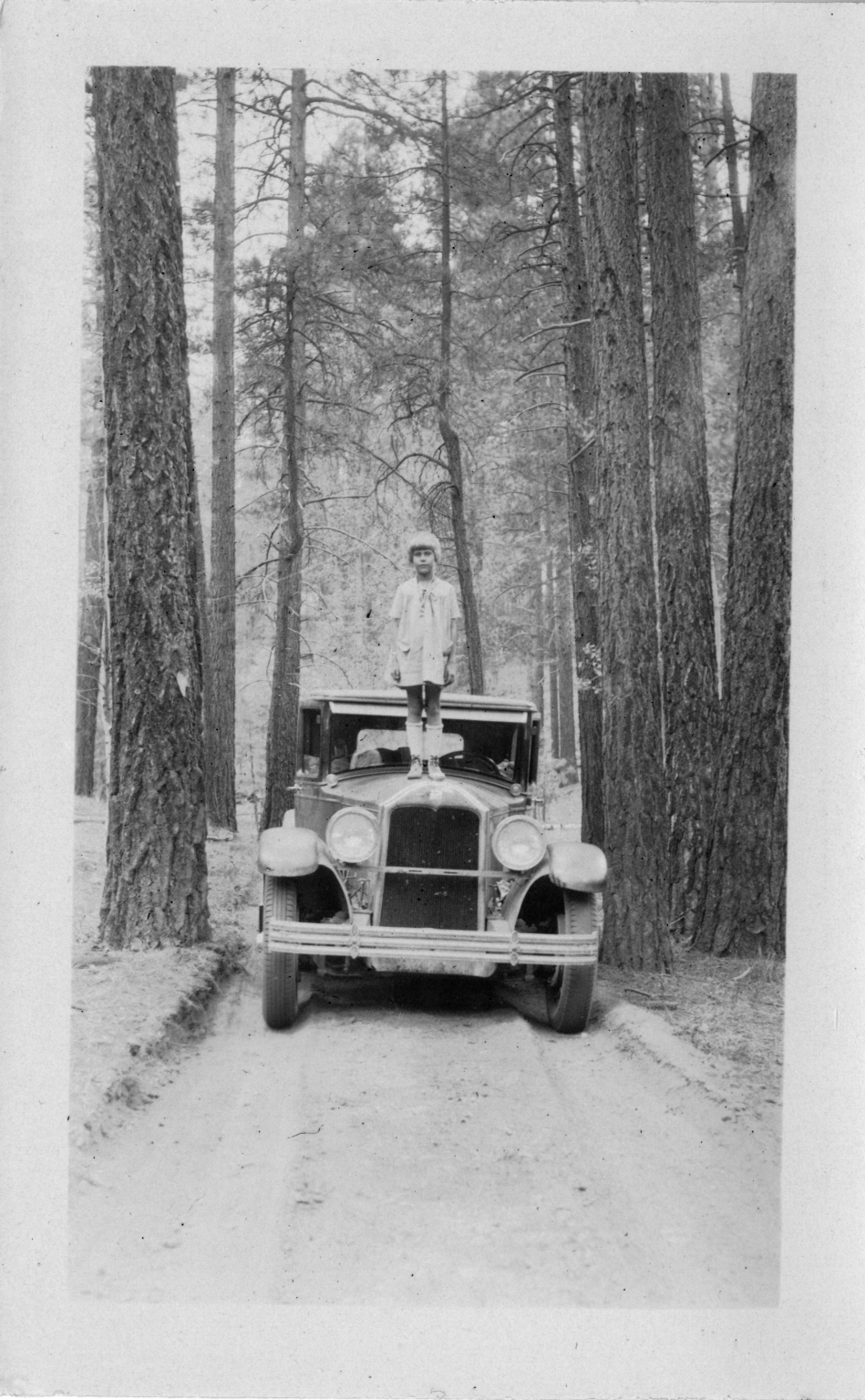 Alice standing on automobile