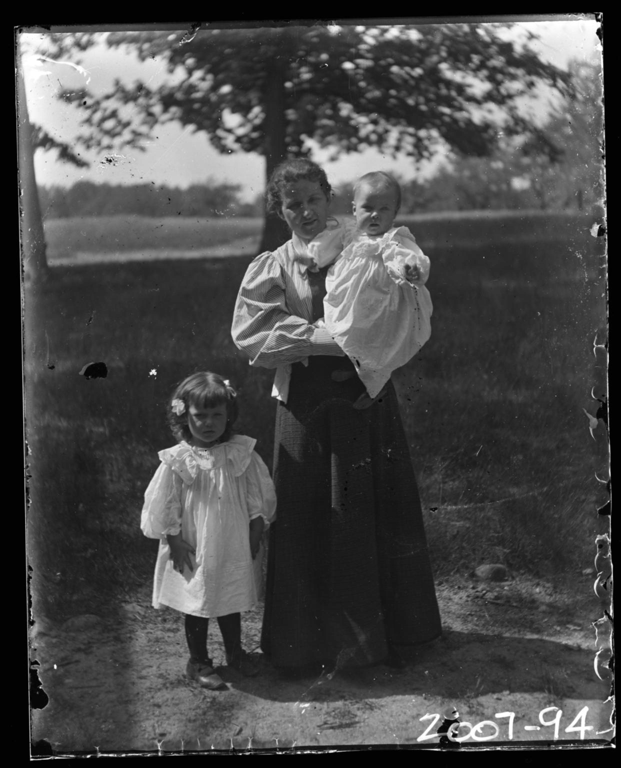 Mrs. J D Figgins with her children